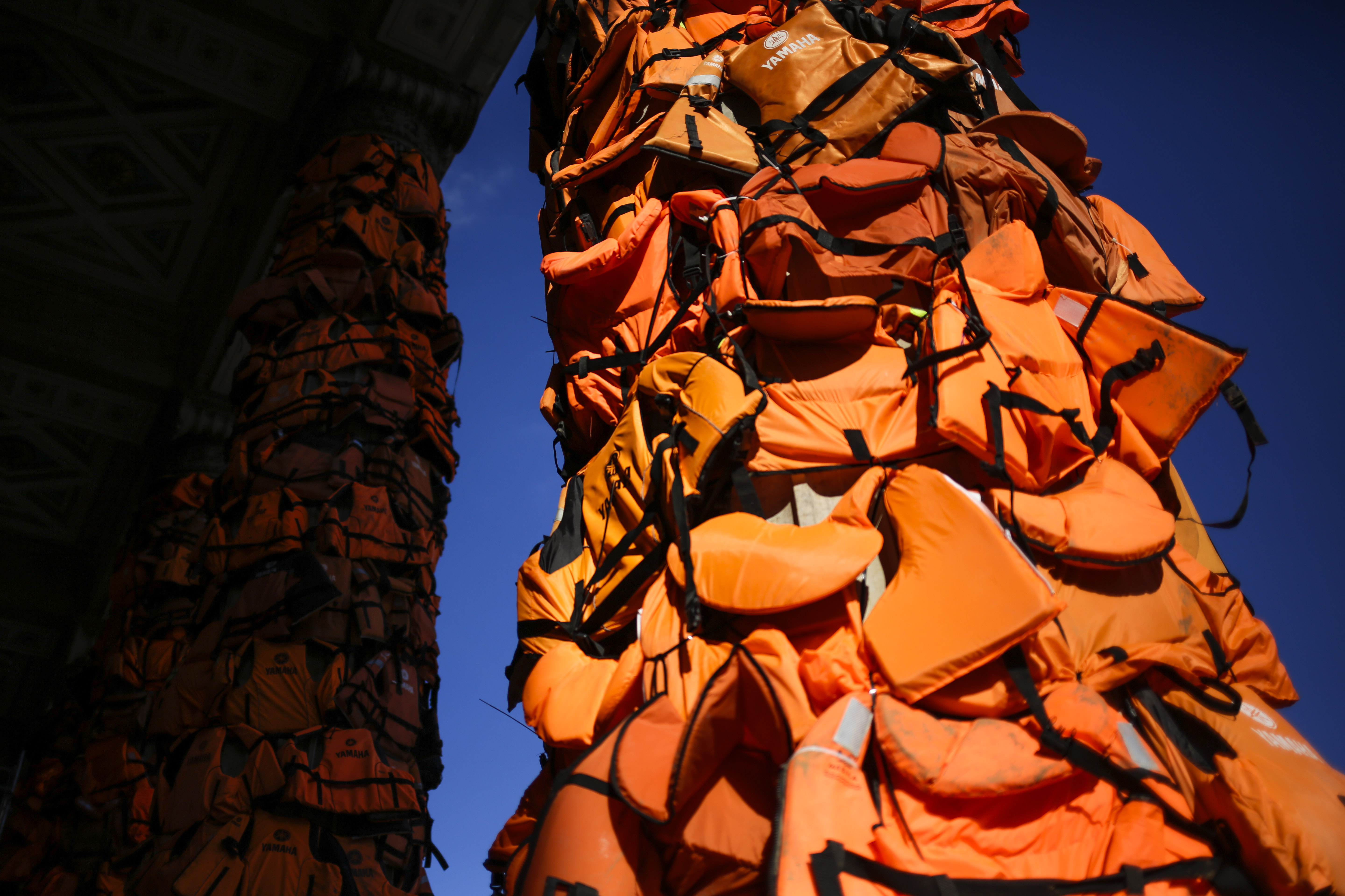 A art installation by Chinese artist Ai Weiwei with life vests used by refugees and collected on the Greek island of Lesbos is set up at the Konzerthaus Berlin (Concert Hall Berlin) for the Cinema For Peace gala alongside the 2016 Berlinale Film Festival in Berlin, Saturday, Feb. 13, 2016. The charity gala will take place at the Konzerthaus on Monday, Feb. 15, 2016. (AP Photo/Markus Schreiber)