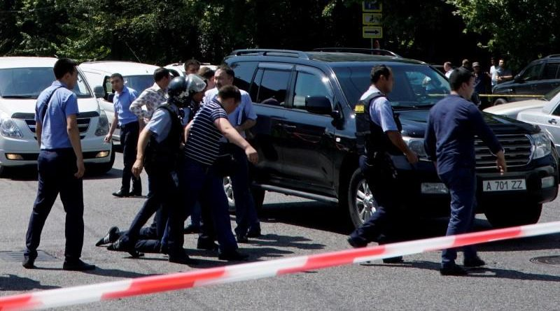 Police officers detain man after attack in centre of Almaty