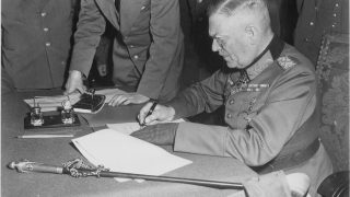 lossy-page1-1163px-Field_Marshall_Wilhelm_Keitel,_signing_the_ratified_surrender_terms_for_the_German_Army_at_Russian_Headquarters_in..._-_NARA_-_531290.tif