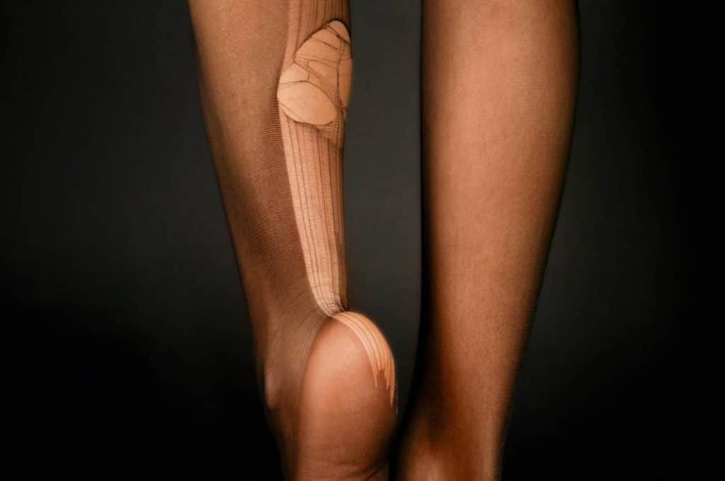 Back of Young Woman's Legs with Huge Run in Stockings